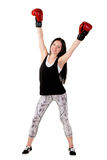 Attractive girl with long hair raised his hands up in red boxing Royalty Free Stock Image