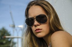 Attractive girl with long hair in sunglasses about helicopter ou Royalty Free Stock Images
