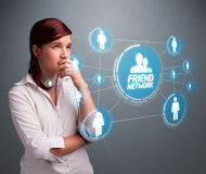 Attractive girl looking at modern social network Stock Photos