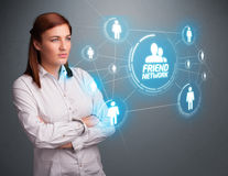 Attractive girl looking at modern social network Stock Image