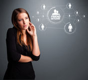 Attractive girl looking at modern social network Royalty Free Stock Photo