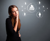 Attractive girl looking at modern social network Royalty Free Stock Photos