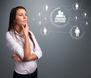 Attractive girl looking at modern social network Stock Photography