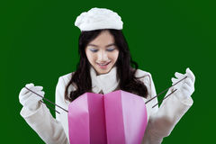 Attractive girl looking at the shopping bag Stock Photos