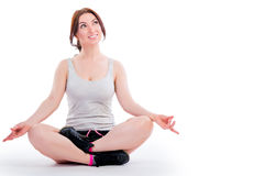 Attractive girl in the lotus position. On a white background Stock Image