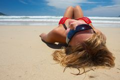 Attractive girl is lying on the beach Stock Photo