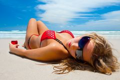 Attractive girl is lying on the beach Stock Image