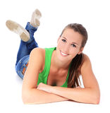 Attractive girl lying on floor Royalty Free Stock Photography