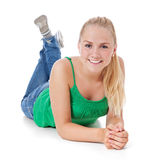 Attractive girl lying on floor Royalty Free Stock Photos