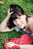 Attractive girl, lying on a grass Royalty Free Stock Photography