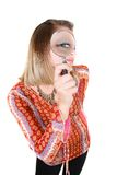 Attractive girl with magnifier Royalty Free Stock Image