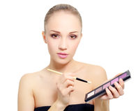 Attractive girl with makeup palette Stock Photo