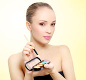 Attractive girl with makeup palette Royalty Free Stock Photography