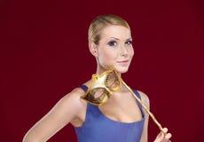 Attractive girl with masquerade masque Royalty Free Stock Photos