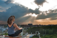 Attractive girl meditating at sunbeam Royalty Free Stock Image