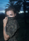 Attractive girl with military style jacket isolated on green field Stock Image