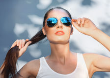 Attractive girl in mirrored blue sunglasses royalty free stock photo