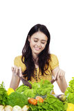 Attractive girl mixing the vegetables salad stock photo