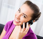 Attractive girl with mobile phone Royalty Free Stock Photography
