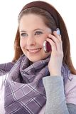 Attractive girl on mobile smiling Royalty Free Stock Photography
