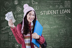Attractive girl with money and folder Stock Photography