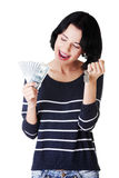 Attractive girl with money and house on hands. Isolated on white Royalty Free Stock Images