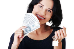 Attractive girl with money and house on hands. Isolated on white Stock Photos