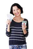 Attractive girl with money and house on hands. Isolated on white Stock Photography