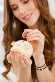 Attractive girl with moneybox. Cute, beautiful woman with moneybox Royalty Free Stock Images