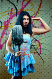 Attractive girl with a mop Royalty Free Stock Image