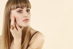 Attractive girl with natural make-up and jewelry Royalty Free Stock Photo