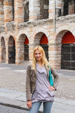 Attractive girl near the Arena of Verona in Italy Stock Photo