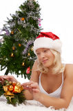 Attractive girl near christmas tree. Portrait of smiling sexy christmas woman decorating christmas tree Stock Images