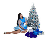 Attractive girl near Christmas tree and gifts Stock Image