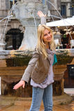 Attractive girl near a fountain of Madonna in Verona, Italy Royalty Free Stock Image