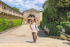 Attractive girl near the grotto Buontalenti in the Boboli garden Stock Images