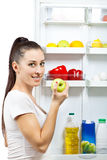 Attractive girl near the open refrigerator Royalty Free Stock Image