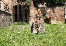 Attractive girl near the picturesque ruins of Rome, Italy Stock Image