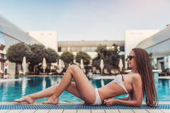 Attractive girl near swimming pool Royalty Free Stock Photo