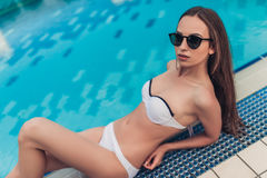 Attractive girl near swimming pool Royalty Free Stock Photos
