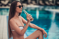 Attractive girl near swimming pool Stock Photography