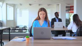 Young manager can`t concentrate in open space office worker in start up company