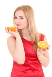 Attractive girl with orange Stock Photos
