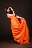 Attractive Girl In Orange Fabric Stock Image