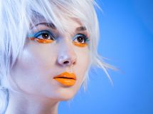 Attractive girl with orange lips Royalty Free Stock Image