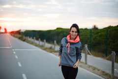 Attractive girl out for an evening jog in the cool day Stock Photo