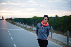 Attractive girl out for an evening jog Stock Photography