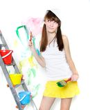 Attractive girl with paintbrush Royalty Free Stock Image