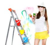 Attractive girl with paintbrush Stock Photos
