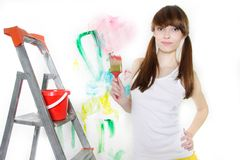 Attractive girl with paintbrush over white Royalty Free Stock Image